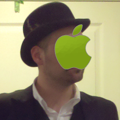 Jonathan wearing a hat with apple logo covering his face