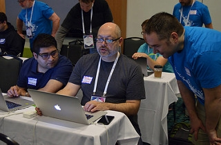 Dan helping a sprinter at DrupalCon Nashville First Time Sprinter Workshop