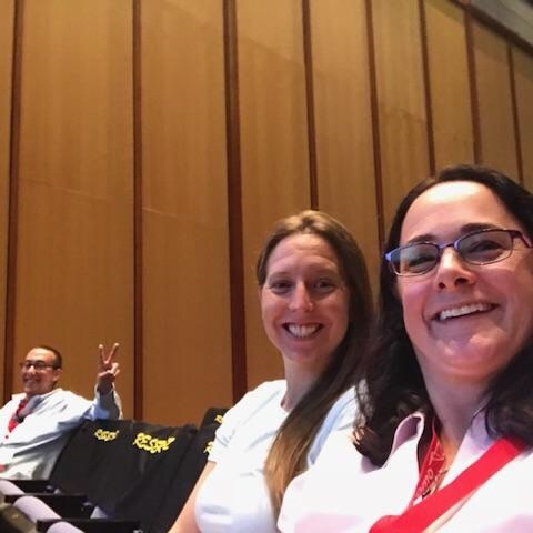 Aimee, Adam, and Lindsay enjoying a session at Drupal GovCon